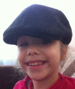Polina wearing her dad's hat during a recent trip to Russia that her parents took to see her and attend court sessions. What a cutie!