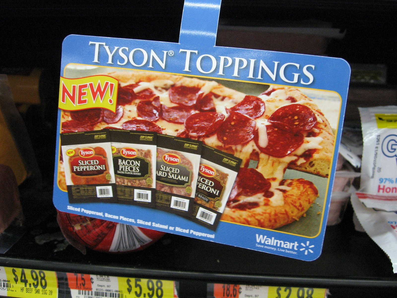 It always helps me to know what I'm looking for and what it looks like. These directional signs with all four varieties of Tyson Toppings made that easy at Walmart.