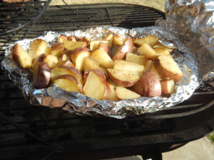 Cut new potatoes with olive oil and peppercorn pepper are great on the grill.