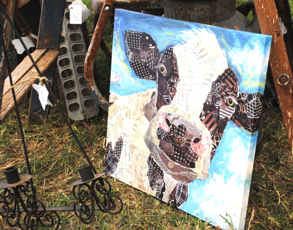 This picture looks like a mosaic (picture created from tiny pieces of other items, like glass). But it's really a painting. Don't know why I took a picture of a picture of a cow, but it just caught my attention so I snapped away!