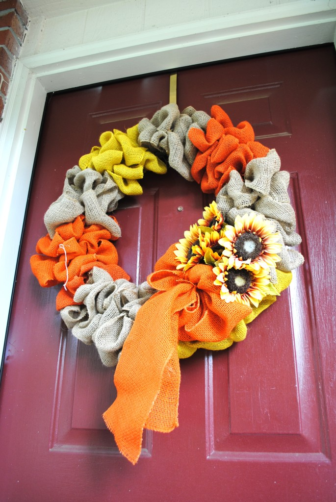 I realized when I was inserting this picture that I forgot to remove the string for the price tag but you still get the idea. This wreath looks fantastic on our front door! It works for every season except winter (which is when I want snowmen anyways...it's my thing).