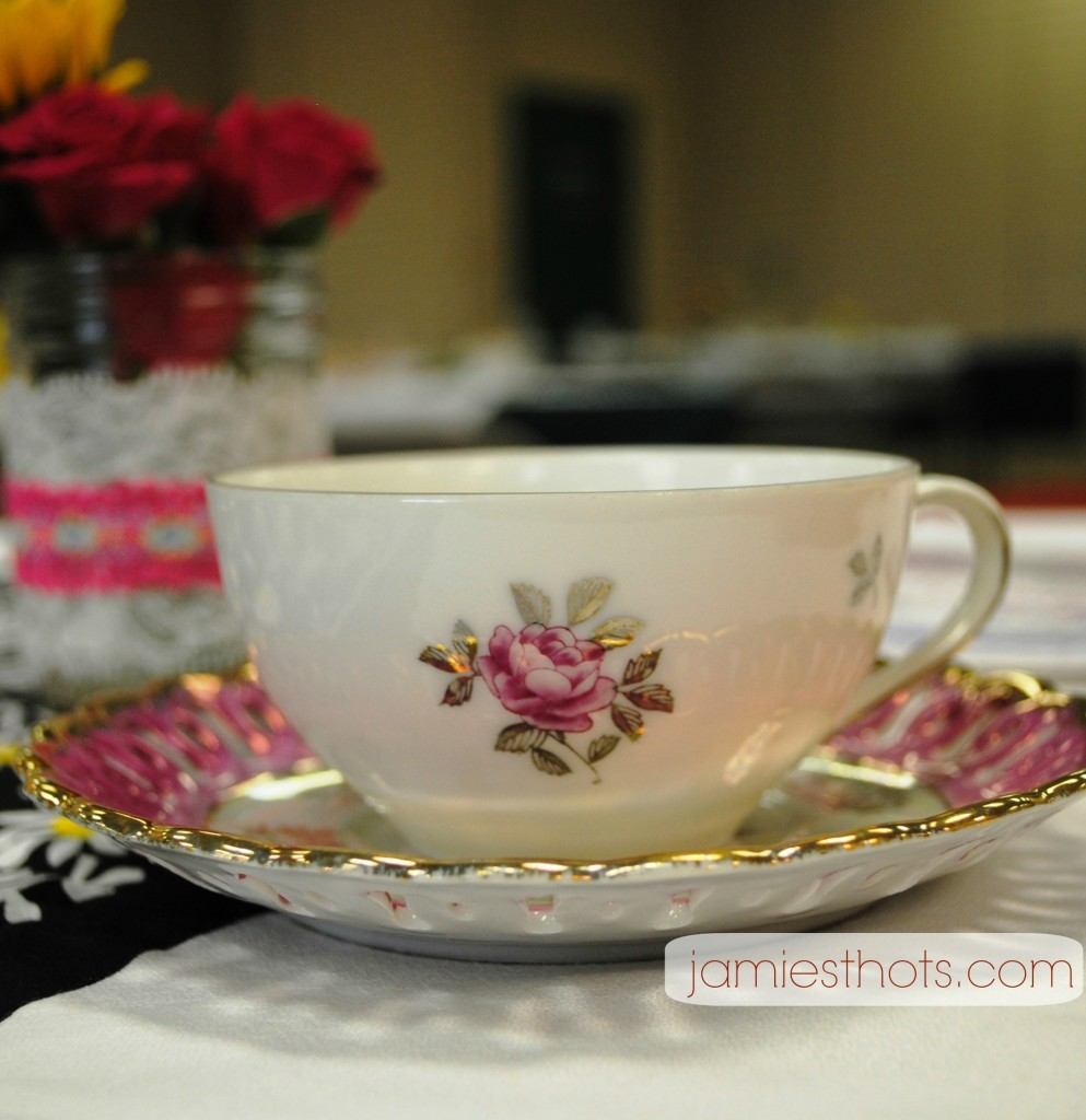 "Isn't this teacup cute! None of the teacups and saucers match but that was on purpose. We did the whole thing in ""shabby chic."""