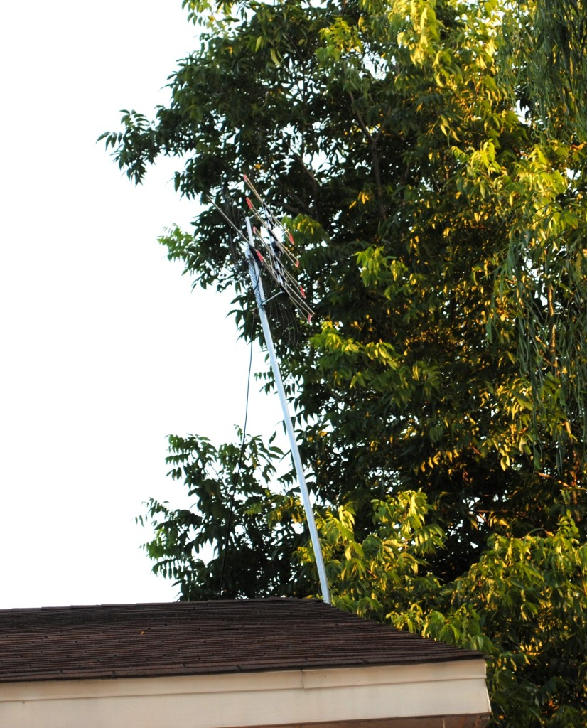 In case you can't tell, that's our antenna we bought when we moved to Elkins. It got damaged in last week's storm (that's why it's leaning funny). By not having cable we are able to save lots of money each month that we put towards paying more important bills.