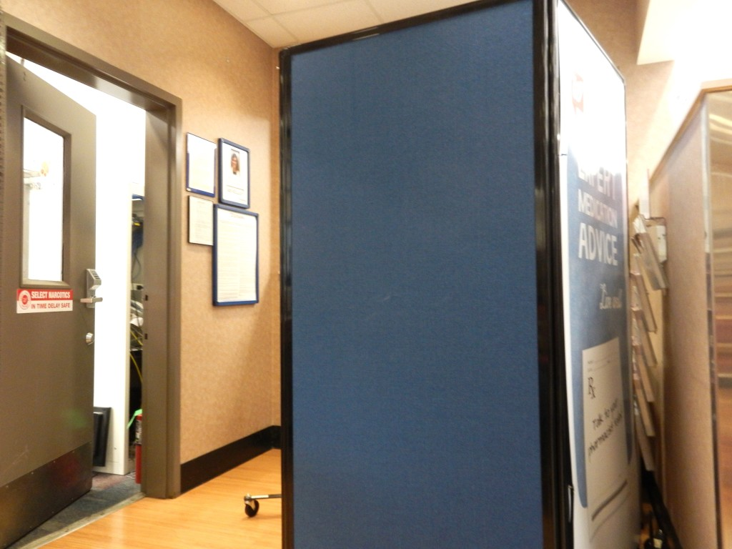 This non-descript blue partition is where you go behind to receive the shot. It protects your privacy!