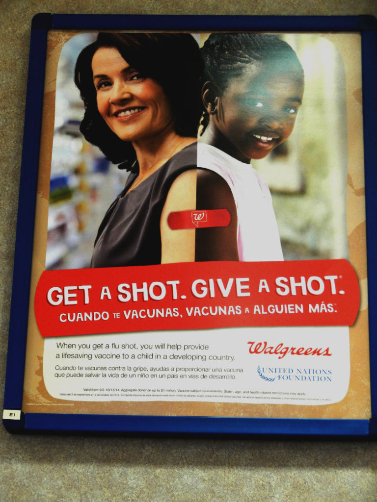 This sign is in the Walgreens pharmacy area that reminds people how they can Get a Shot. Give a Shot.