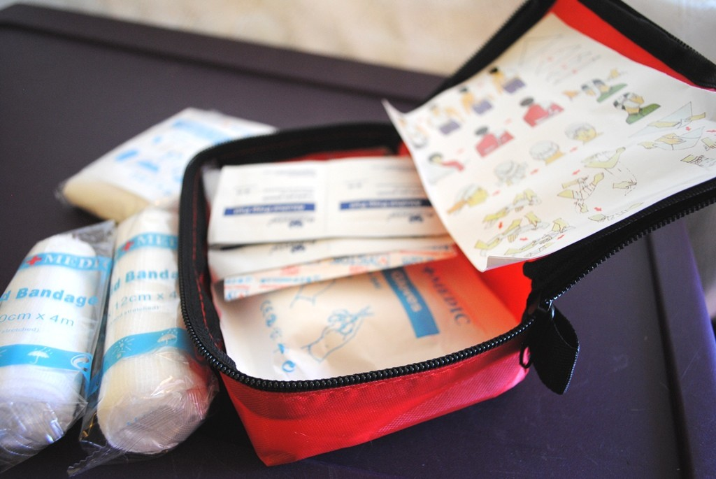 You need a first-aid kit that you either create or purchase as a kit. I have a easy kit. Also grab your medicines that you take on a regular basis. With insurance being the way that it is, you can't easily get spare meds so I would recommend getting your medications together in a bag when you first learn there might be bad weather in your area. That makes it easy to grab.