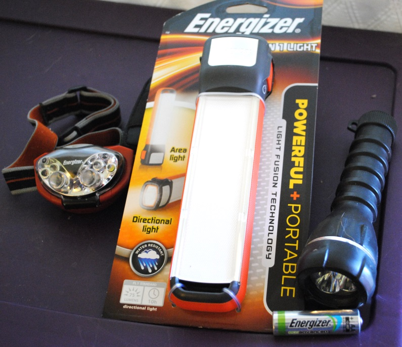 Flashlights are vital for any preparedness kit. I suggest packing them very last so that they are on top when you open the kit. That way, you aren't rummaging in the dark when the lights go out. We have small flashlights for each person, a head lamp that is great for anyone who might struggle with holding a flashlight (like a disabled person or a child), and a light that can work as either a flashlight or a whole room light.