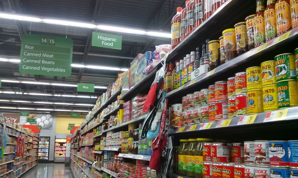 The diced jalapenos were in the general Mexican food aisle. I first grabbed the ones you use for nachos then found the diced ones in the area where you get enchilada ingredients. I got canned jalapenos but should have bought a jar so I could use a lid for the remaining peppers.