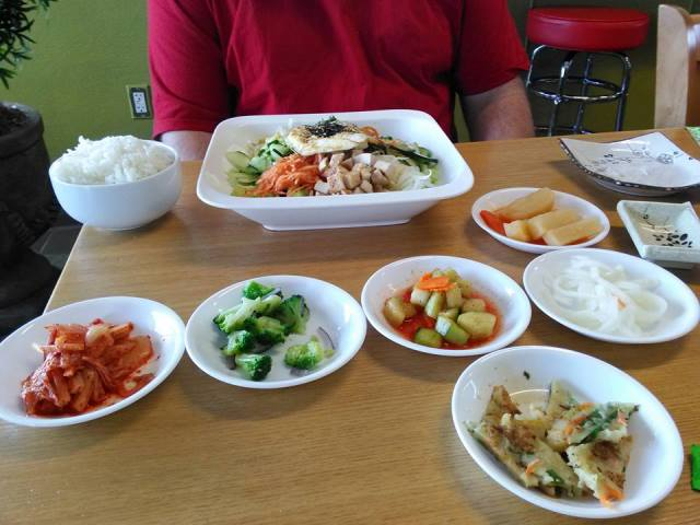 They bring all the components of the bibimbap in separate little dishes so the person can blend it themselves.