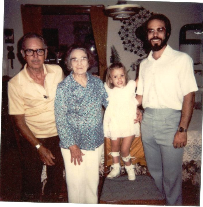 I grew up reasonably healthy and happy. Here I am with my grandpa, great-grandma and my dad. This would have been taken in the very late 1970s or early 1980s.