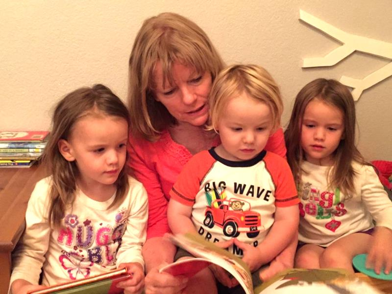 My mom reading to her three grandkids. My twin nieces and nephew love being read to! I don't get to see them nearly enough but I love picking out books to send them. I'm using my codes from Kellogg's to get books for them.