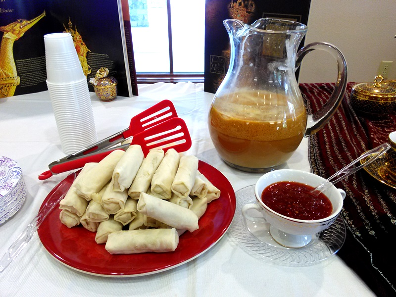 A closer look at the Thai Milk Tea and spring rolls.