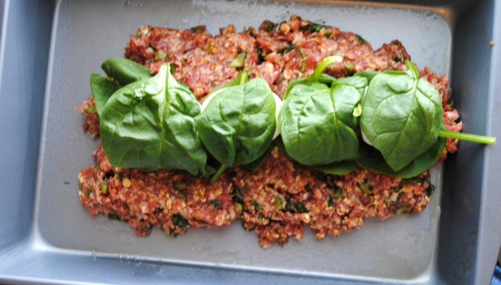 The four eggs laid end to end and wrapped in spinach.