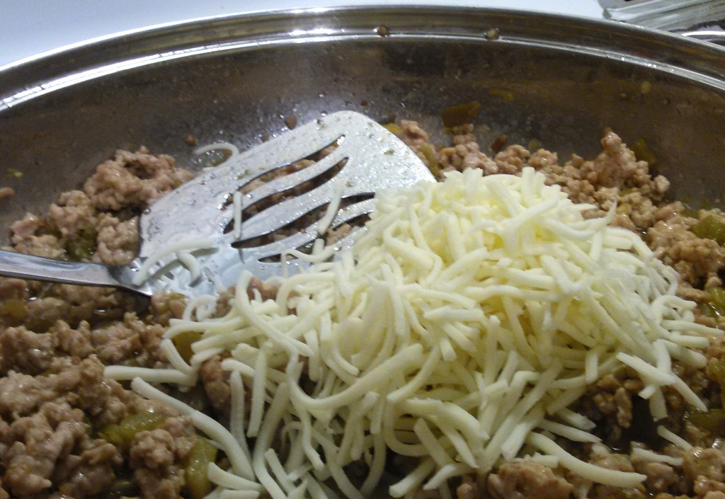 Add in about a cup and a half of Kraft mozzarella shredded cheese to complete your mix.