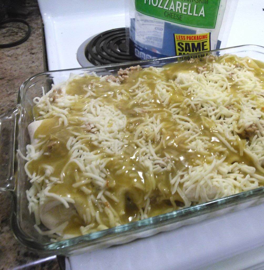 Drizzle the remaining 1/3 can of sauce over the enchiladas before baking.