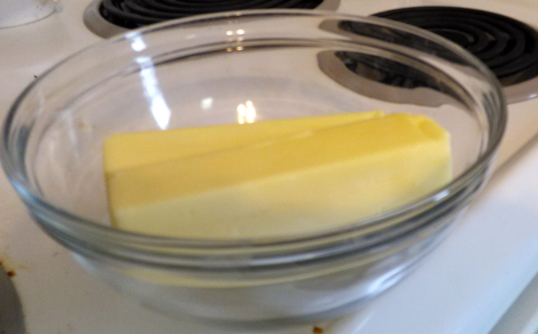 Tip: I put both sticks of butter straight from the refrigerator in a glass bowl. I placed the bowl on top of the stove so the heat from the oven below would slightly warm it to room temperature.