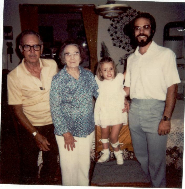 This picture is more than 30 years old and is a scan of a Polaroid (remember those?). That's my grandpa on the far left, Grammy (great-grandma), and my dad. Oh, and that cute little girl is me! Grammy would make Cornish hens for the family for special occasions.