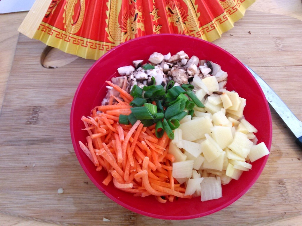 Prepare the green onions, mushrooms, bamboo shoots, and carrots.