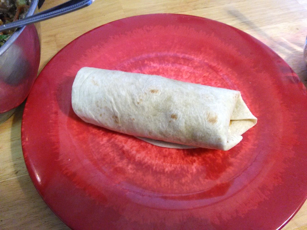 "Roll up the tortilla to make an almost ""burrito."""
