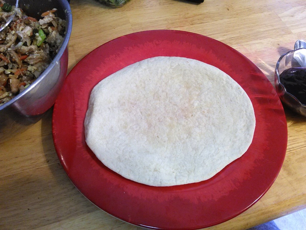 Lay a tortilla flat.