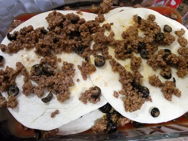 Repeat the process but with the second layer or meat you will only put about 1/3 of the mixture on top of the second layer of tortillas.