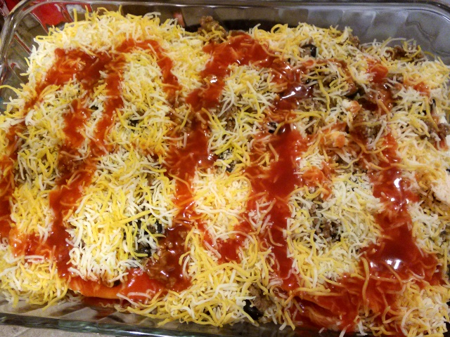Drizzle the remaining 1/3 can of enchilada sauce over the entire casserole.