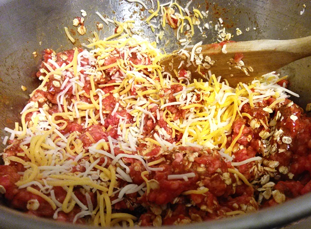 "Mix in 1/2 cup of the finely shredded cheese. I emphasize finely (or ""fancy) shredded because regular shredded will make it too greasy."