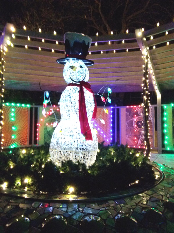 I want this for my yard! I love snowmen and this was a perfect place for it in the children's garden.