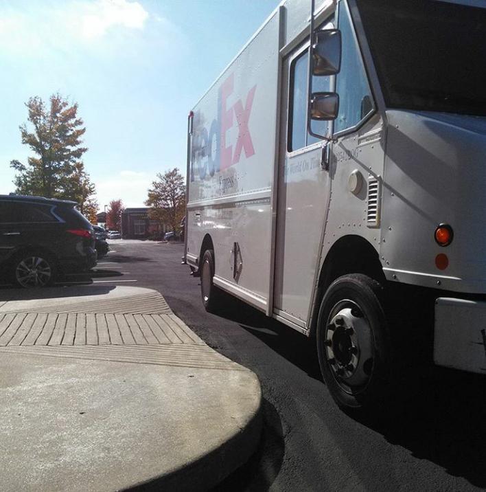 FedEx truck blocking a wheelchair ramp